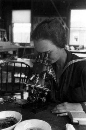 Nancy Wilson looking through microscope