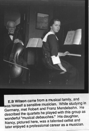 Wilson on left playing cello and Nancy at piano, both looking at camera